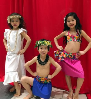 Three of our keikis (kids) performing at another mall